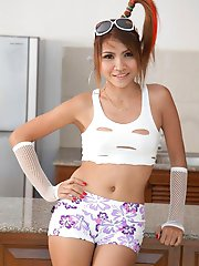 Really hot Thai girl Lamai with a pony tale strips to show her mega hot body