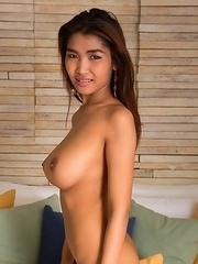 Busty thai babe Tittiporn in black lingerie