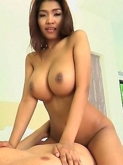 Busty Asian cutie Tittiporn strip and fuck